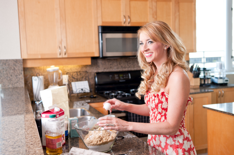 woman cooking in kitchen happy